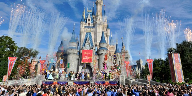 This image released by Disney shows fireworks punctuating the sky at the grand opening celebration at the Cinderella Castle for the New Fantasyland attraction at the Walt Disney World Resort's Magic Kingdom theme park in Lake Buena Vista, Fla., Thursday, Dec. 6, 2012. The new attraction is the largest expansion at the Magic Kingdom. (Gene Duncan, photographer)